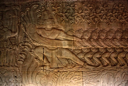 a tug of war, seemingly. This is also depicted in large statues outside of the gates of Angkor Thom