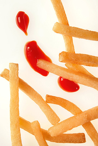 ARS research has shown heating French fries with infra-red light before cooking can lower the amount of oil in the finished fries.