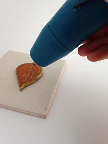 CraftyGoat's Notes: Make liquid clay clear as glass by setting with heat embossing gun