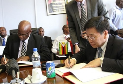 Republic of Zimbabwe Minister of Finance Patrick Chinamasa along with  Vice-President of the People's Republic of China Import-Export Bank Zhu Hongjie signing a $318 million hydro power contract in Harare. by Pan-African News Wire File Photos