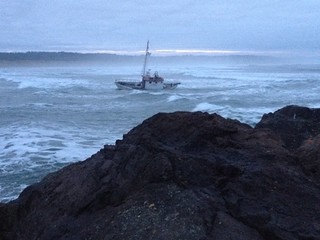 Coast Guard Station Yaquina Bay, Ore., and Incident Management Division from Sector Columbia River, Ore., respond to a fishing vessel that ran aground approximately 50 yards south of Yaquina Bay, Dec. 14, 2013. (Photo by U.S. Coast Guard)