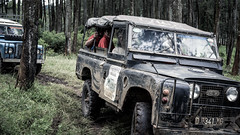 automobile(1.0), automotive exterior(1.0), sport utility vehicle(1.0), vehicle(1.0), land rover(1.0), off-roading(1.0), land rover defender(1.0), off-road vehicle(1.0), land rover series(1.0), bumper(1.0), land vehicle(1.0), safari(1.0),