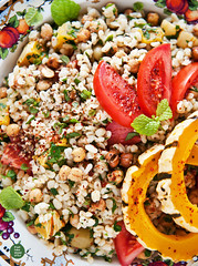 Bulgur salad with roasted delicata squash and chic…