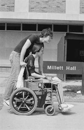 Students wheelchair outside Millett Hall 8408-10-3-24a