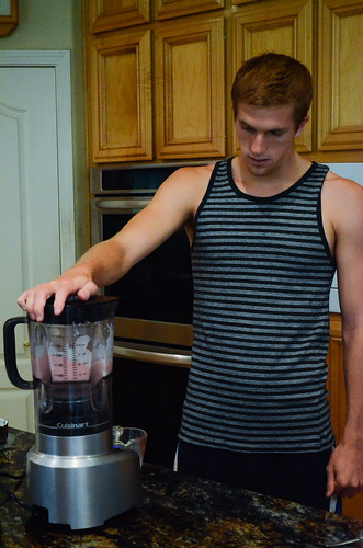 Boy #4 using a blender to make a smoothie.