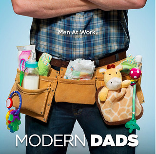 A dad wearing a tool belt full of baby toys in an ad for Modern Dads