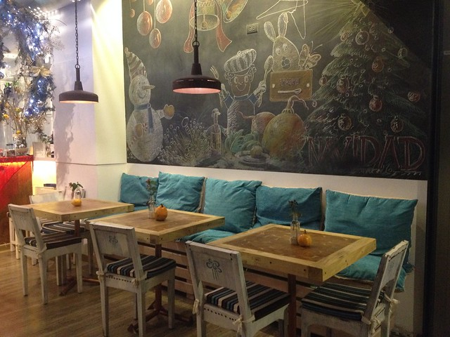 Comfortable seating and a decorative chalkboard