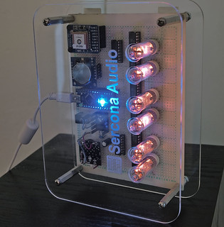 top of nixie clock, sitting on its side for a pose