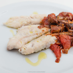 Plate with steamed red gurnard with baked pieces o…