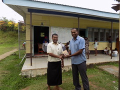 Wainibuka District School Principal Mr Andrew Simpson receiving the Goodnews Bible from our BSSP Mission & Fundraising Coordinator Charles Cleary.