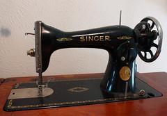 home appliance(0.0), sewing machine(1.0), art(1.0), iron(1.0),