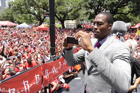 July 13, 2013 - Dwight Howard takes a photo of the crowd that came to greet him at his welcome rally