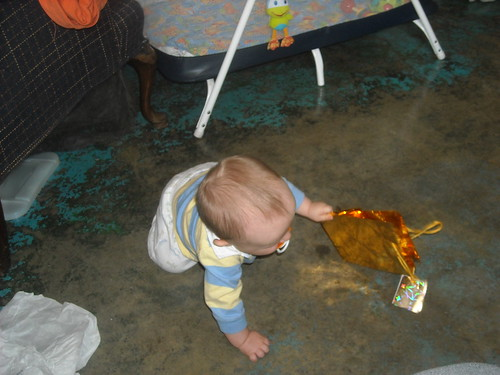 Crawling and playing with a shiny gift bag