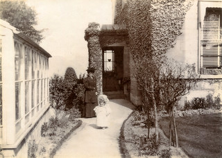 """Claremont, Bath. 1907"" Woman and child in a front garden."