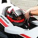 Juan Pablo Montoya gets strapped into his machine during the Team Penske test at Sebring