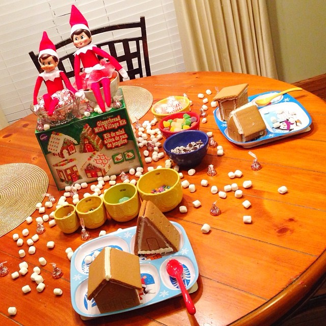 Tonight while the kids are asleep, Elfie and Samantha brought a mini gingerbread village with four houses to decorate with lots and L.O.T.S. of candy!! One of the houses looks kind of like an out house???! Hmmm, Nathan will get a kick out of that one for