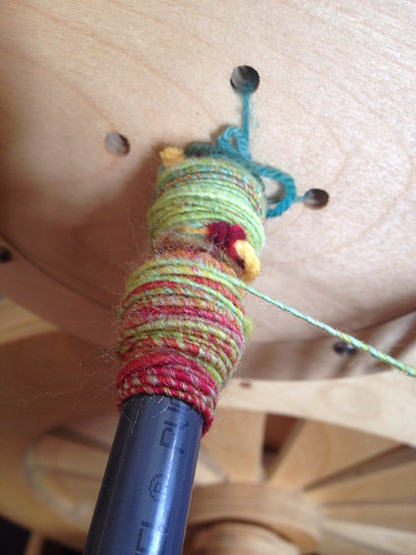 Happy Hooves batt corespun over a weaving thread.