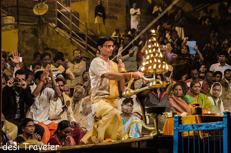 Priest with oil lamp evening Ganga Aarti Varanasi Dashashwamedh Ghat