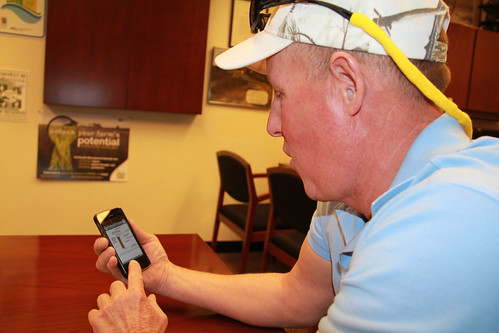 Keith Johnson checks the latest from NRCS Minnesota and the other people and groups he follows on Twitter on his phone.
