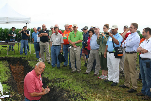 NRCS Soil Scientist Roger Windhorn shows participants the differences in soil layers and what makes a healthy soil.