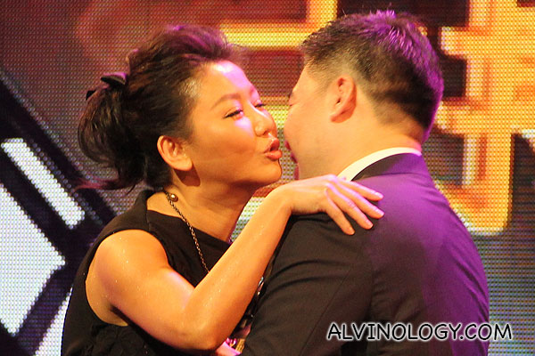 Pauline Lan getting affectionate on stage