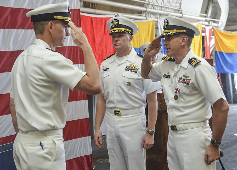 PEARL HARBOR - Cmdr. Patrick C. Thien, commanding officer of the littoral combat ship USS Freedom (LCS 1), relinquishes his duties as he salutes Capt. Randy Garner, commodore of Littoral Combat Ship Squadron One, during a change of command ceremony.