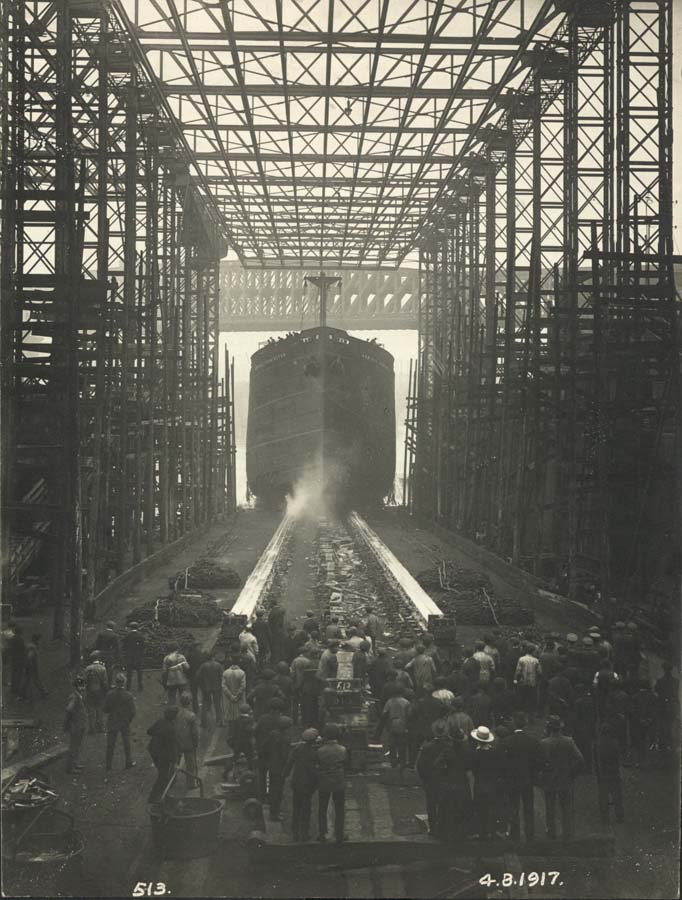 Workers watch the launch of 'Admiral Codrington'