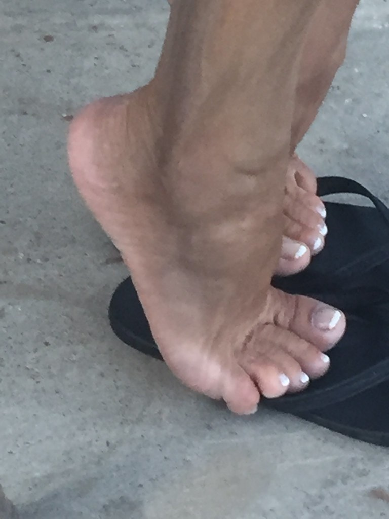 Candid feet in flipflops at the tax collector