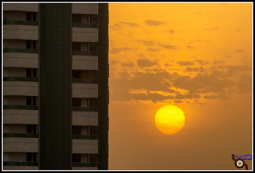 morning cloud sun tower buildings sharjah unitedarabemirates