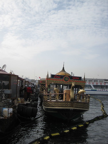 Boats along the Bosporus selling fish sandwiches with the Süleymaniye Mosque in the background
