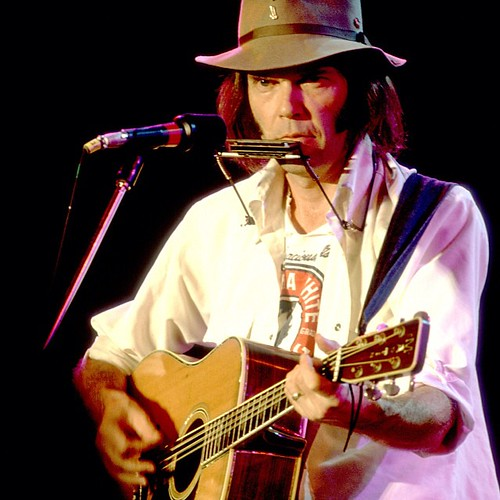 Farm Aid co-founder and board member Neil Young at the first #FarmAid concert in Champaign, IL in 1985. Photo by Paul Natkin. #neilyoung #tbt #throwbackthursday