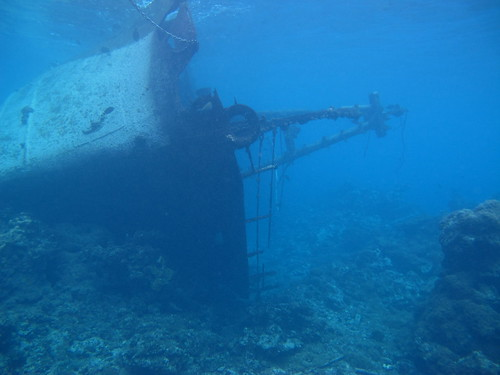 The F/V Hui Feng No.1 grounded on the reef and lying on her side at the Palmyra Atoll National Wildlife Refuge (Dec. 2012).  Photo credit:  Susan White/USFWS