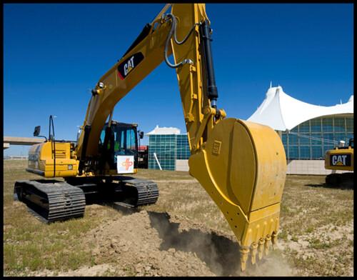 Photo of excavator digging in soil at East Rail Line groundbreaking