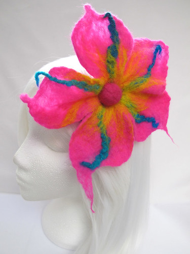 Large felt hair flower on a ribbon-covered comb