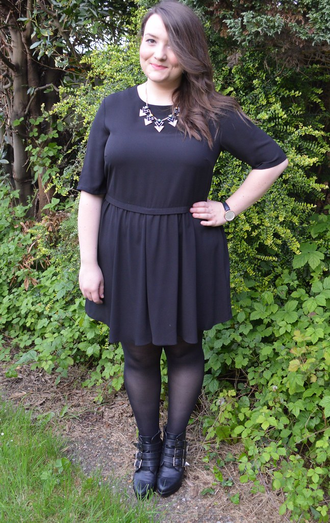 This is a picture of a warehouse black smock dress