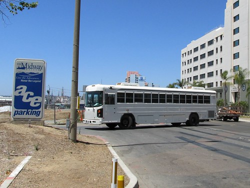 A modified Bluebird school bus operating as a sightseeing tour bus.  San Diego California.  June 2013. by Eddie from Chicago