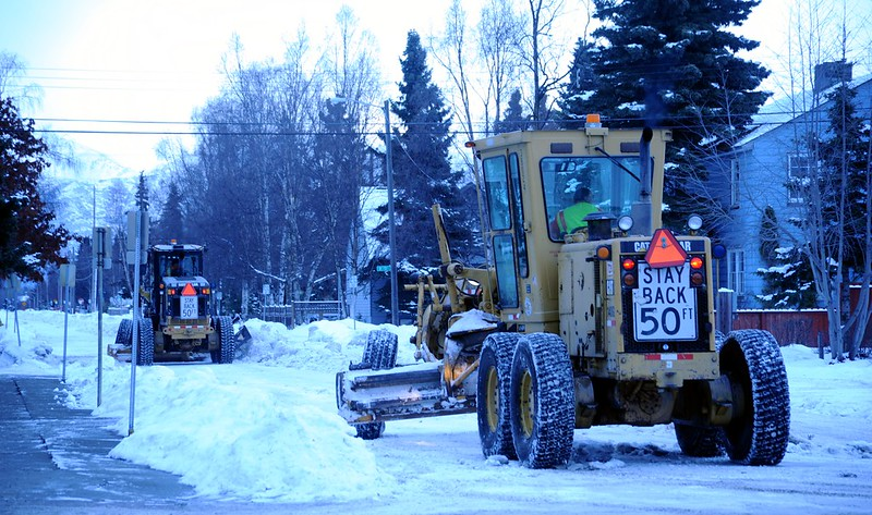 Stay back 50ft, snow removal with snow grators, 6 wheeled tractors plowing snow from city streets, cloudy day, mid-winter, Anchorage, Alaska, USA