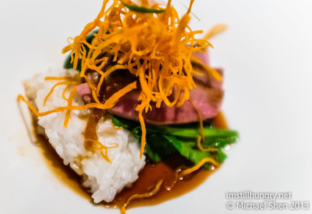 Chinese style roast duck, green chilli and oyster sauce dressing with coconut rice and mustard greens Ezard