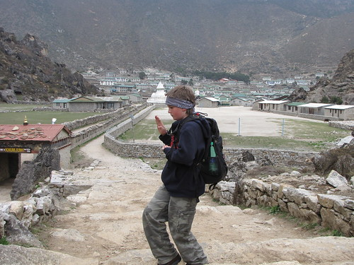 Me standing outside of Khumjung doing a karate pose