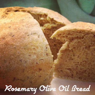Rosemary Olive Oil Bread with a slice cut out