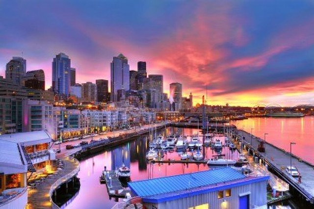 10613576-famous-seattle-skyline-dazzling-under-a-beautiful-dawn-sky-across-pier-66-waterfront