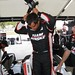 Juan Pablo Montoya climbs out of his car after his seat fitting at Sebring