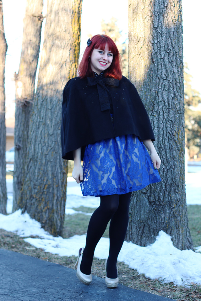 A Holiday Outfit Blue Lace Dress Black Capelet And