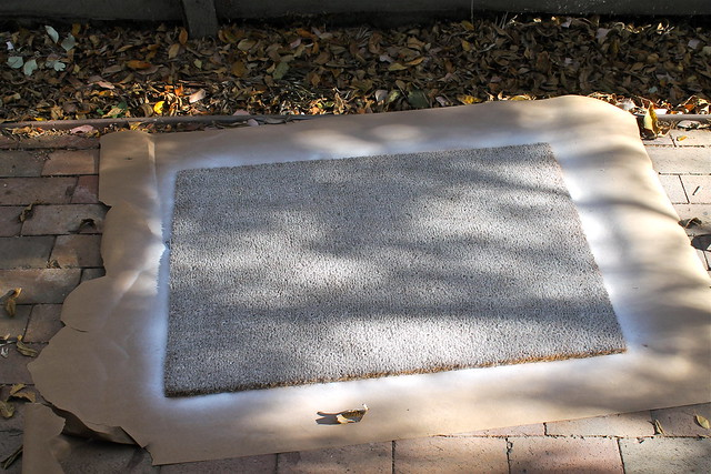 step two of how to spray paint an IKEA doormat