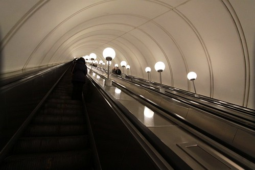 Climbing out of the station on the 126 metre long escalator