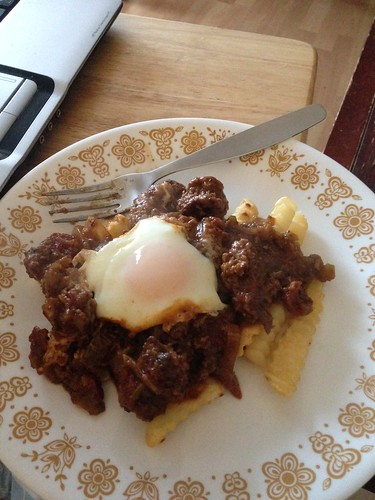 Leftover Swiss steak over fries with a poached egg...yes please! by gmwnet
