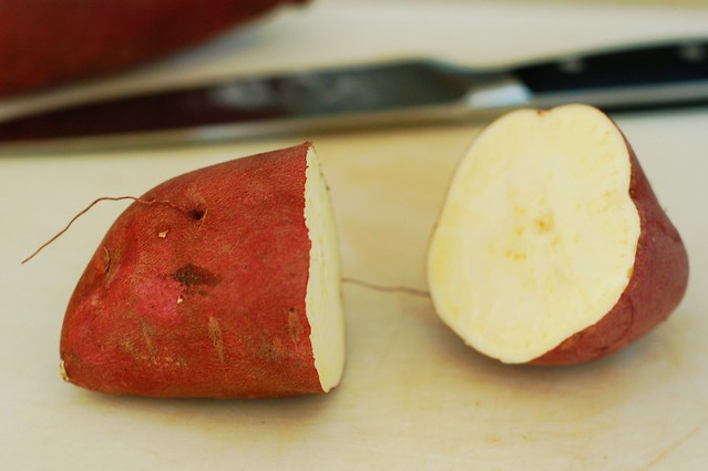 Cutting the sweet potatoes in half by Eve Fox, the Garden of Eating blog, copyright 2014