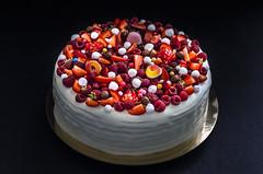 Honeycake with berries. Dark background