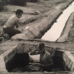 danny lyons-- migrant workers bathin in citrus irrigation canals