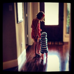 She is helping him walk. #littlesteps #sheloveshim